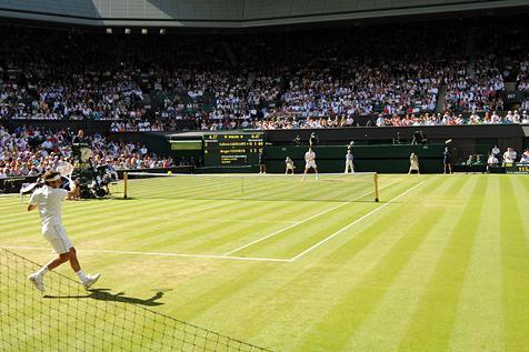 Federer, bailando na grama